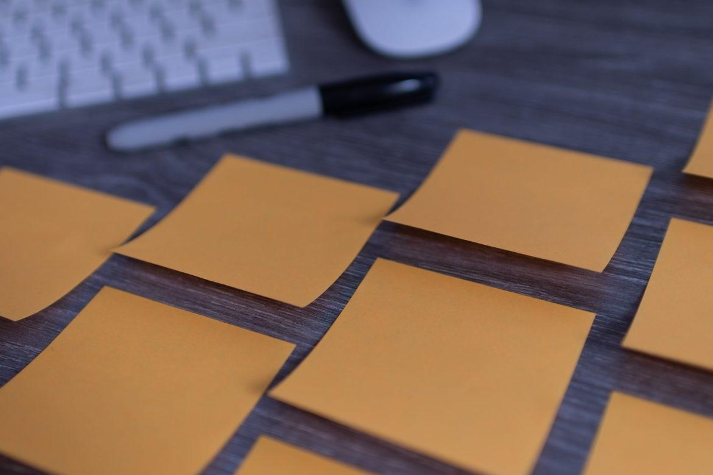 orange sticky notes on silver imac photo