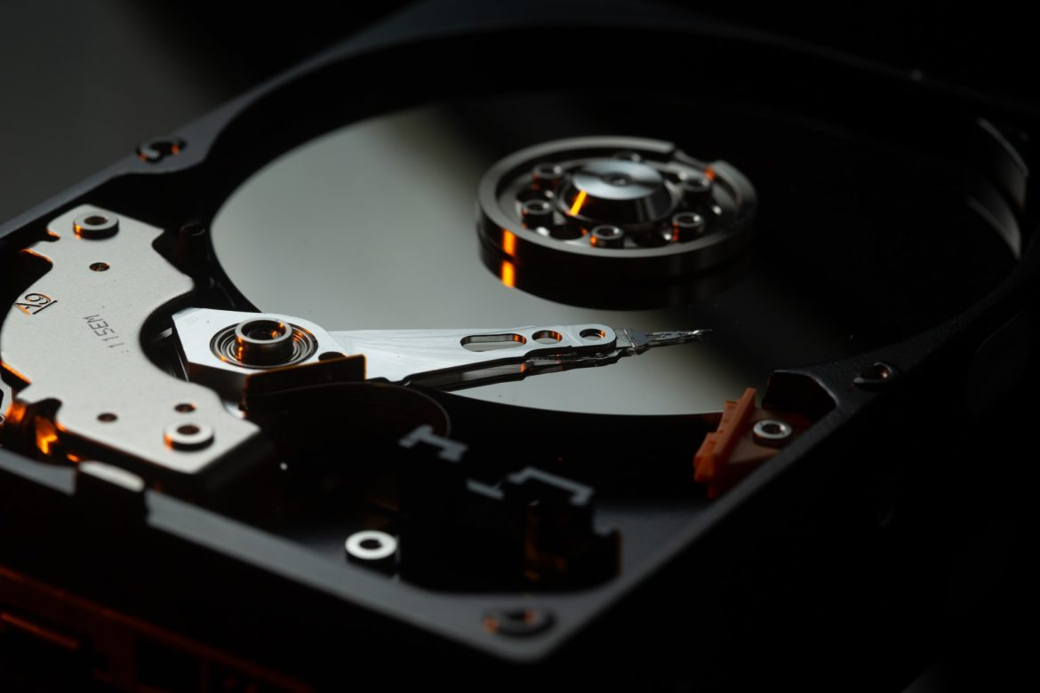 The inside of a hard drive is exposed.