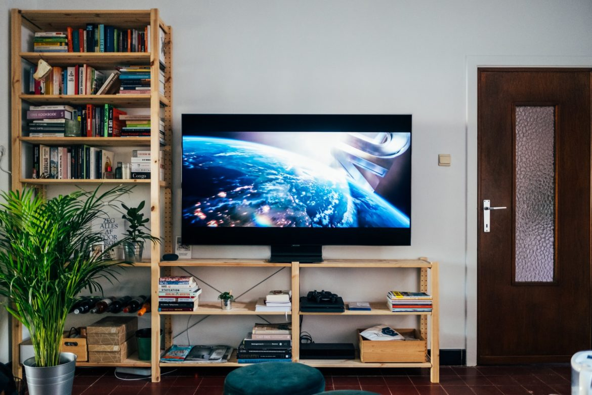 Television on book shelf in living room